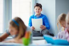 Schoolboy in classroom Royalty Free Stock Photos