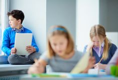 Schoolboy in classroom Royalty Free Stock Photography