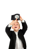 Schoolboy with clock Stock Images