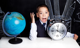 Schoolboy with a clock Royalty Free Stock Photos