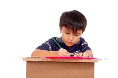 Schoolboy concentrating Royalty Free Stock Photo