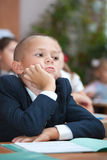Schoolboy in concentration. Intresting Lecture. Real lesson in School stock image
