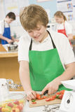 Schoolboy in a cooking class Royalty Free Stock Photo