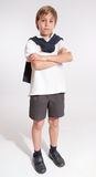 Schoolboy with crossed arms serious Royalty Free Stock Photo