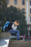 Schoolboy crying on the street. Negative emotion stock images