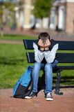 Schoolboy crying on the street Royalty Free Stock Photography