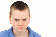 Schoolboy with depressed face Royalty Free Stock Images