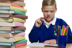 Schoolboy at the desk Royalty Free Stock Photos