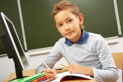Schoolboy at the desk Royalty Free Stock Images