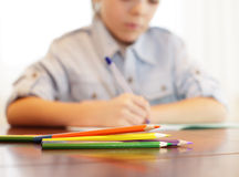 Schoolboy does house lessons Royalty Free Stock Photography