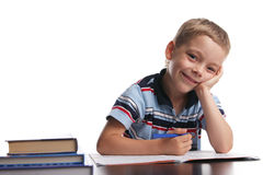 Schoolboy does lessons Royalty Free Stock Image