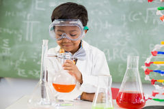 Schoolboy doing a chemical experiment in laboratory Stock Photo