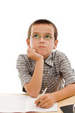 Schoolboy doing his homework. Schoolboy doing bored his homework - isolated royalty free stock photography