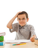 Schoolboy doing his homework. Schoolboy thinking about his homework - isolated royalty free stock images
