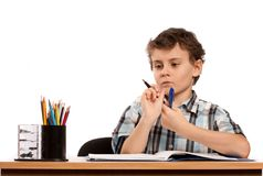 Schoolboy doing homework Royalty Free Stock Photos