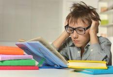 Schoolboy doing homework Stock Image