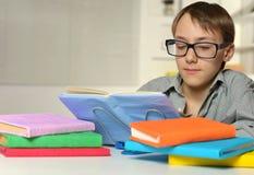 Schoolboy doing homework Stock Photos