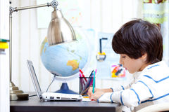 Schoolboy doing homework Royalty Free Stock Photo