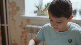 A schoolboy doing homework at home stock video footage