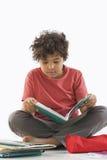 Schoolboy doing homework stock photo