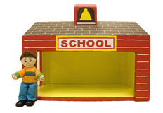 Schoolboy doll and toy schoolhouse Stock Images