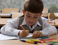 Schoolboy drawing. Portrait of the drawing schoolboy Stock Images