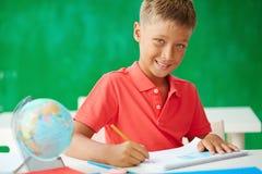 Schoolboy drawing Stock Image