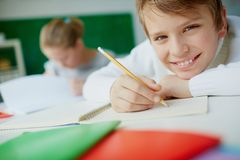 Schoolboy drawing Stock Image