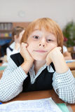 Schoolboy in dreams royalty free stock photo