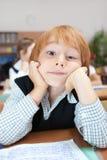 Schoolboy in dreams Royalty Free Stock Photo
