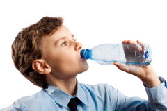Schoolboy drinking water Royalty Free Stock Photography