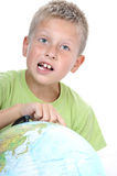 Schoolboy with earth globe Royalty Free Stock Photos