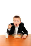 Schoolboy eating Royalty Free Stock Photography