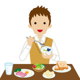 Schoolboy eating  Breakfast- Long Sleeved.  Royalty Free Stock Images