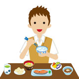 Schoolboy eating Japanese breakfast Royalty Free Stock Photo