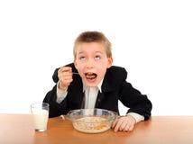 Schoolboy eats Royalty Free Stock Image