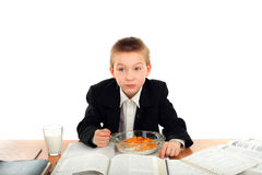 Schoolboy eats Royalty Free Stock Photo