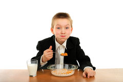 Schoolboy eats Royalty Free Stock Photography