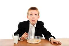Schoolboy eats Royalty Free Stock Photos