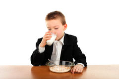 Schoolboy eats Stock Image