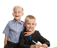 Schoolboy embracing brother Stock Photography