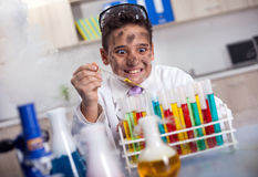 Schoolboy Experiment in the school lab stock image