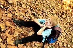 Schoolboy in fall time stock photography
