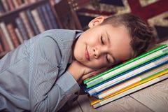 Schoolboy fallen asleep on books Stock Photos