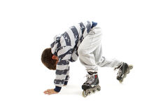 Schoolboy falls over while rollerblading Stock Photo