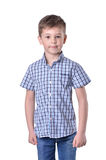 Schoolboy in fashionable blue checkered shirt on white background. Schoolboy in fashionable blue checkered shirt isolated on white background Royalty Free Stock Image