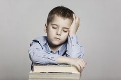 Schoolboy fell asleep at the table with books, toning stock photos