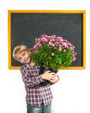 Schoolboy with a flowers Stock Images