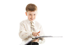 Schoolboy with a folder smiles and points with a finger isolated Stock Photo