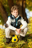 The schoolboy with football's ball Stock Images